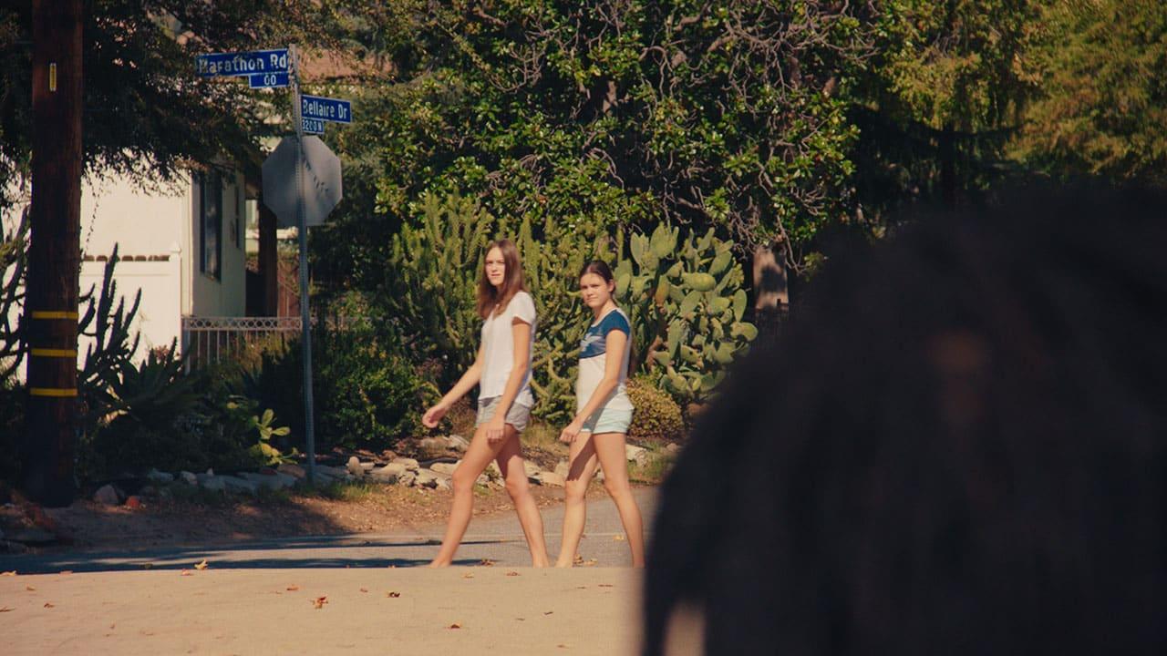Girls Walk Past Bruno