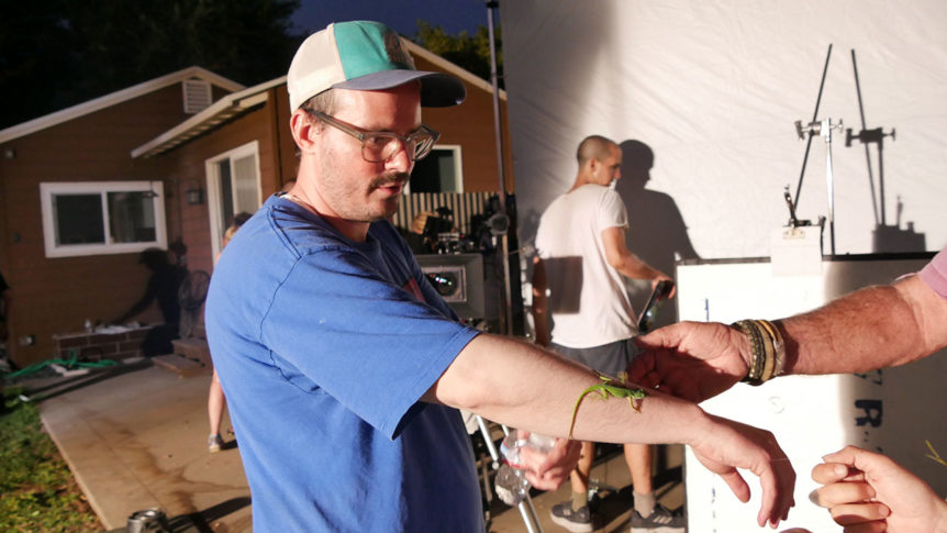 Lizard on director's arm